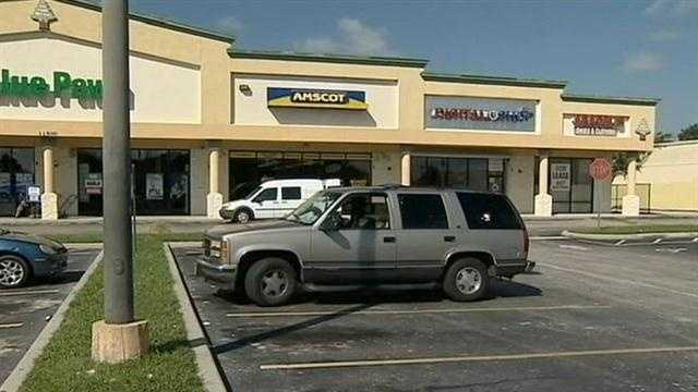 Investigators are looking into the robbery of a check-cashing store in Orange County.