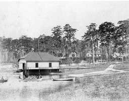 1890s - Boathouse on a lake