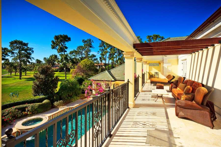 Second floor balcony overlooking the pool and golf course is ideal for tanning or just relaxation.