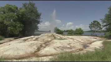The fire-rock geyser sits just off the lodge pool and is inspired by Old Faithful.