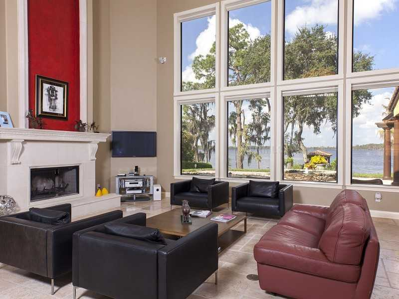 Tall windows letting in plenty of natural light and beautiful views of the water.