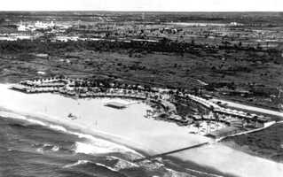 "Boca Raton (Palm Beach County): The Spanish ""Boca de Ratones"" means rat's mouth, a term used by seamen to describe a hidden rock which a ship's cable might rub against.  Picture shows the Boca Raton Club in the 1920s."