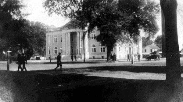 Madison (Madison County): Madison was first called Hickstown, after Seminole Chief John Hicks. Then it became known as Newton. But the mail kept coming addressed to Madison C.H. (meaning the courthouse of Madison Co.), so the locals just dropped the C.H. and used Madison as the town's name.A photo from 1918 is shown of Madison.
