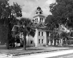 Mayo (Lafayette County): This town is named after James Mayo, a colonel who had been in charge of the Confederate Army. He delivered a speech in the area one Fourth of July and the settlers were so impressed by Mayo that they named their community after him. The picture shows the Lafayette County Courthouse in Mayo in the 1900s.