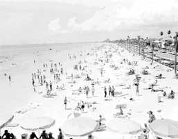 Pass-a-Grille Beach (Pinellas County): The name referred to the practice of fishermen, who would stop here on their way crossing over the island to cook or grill their meals. The picture is of Pass-a-Grille Beach in 1950.