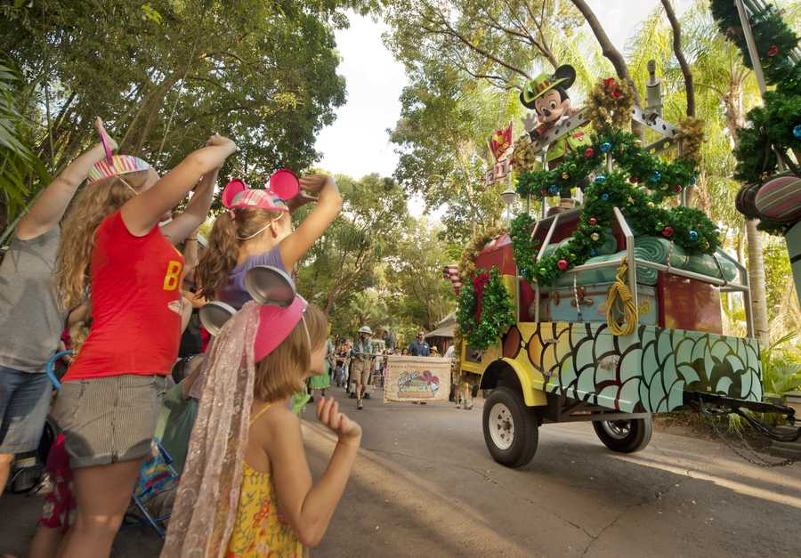 7. Mickey's Jingle Jungle Parade. At Disney's Animal Kingdom guests can celebrate the holidays safari style with Mickey's Jingle Jungle Parade. It features traditional holiday music but with a world beat twist.
