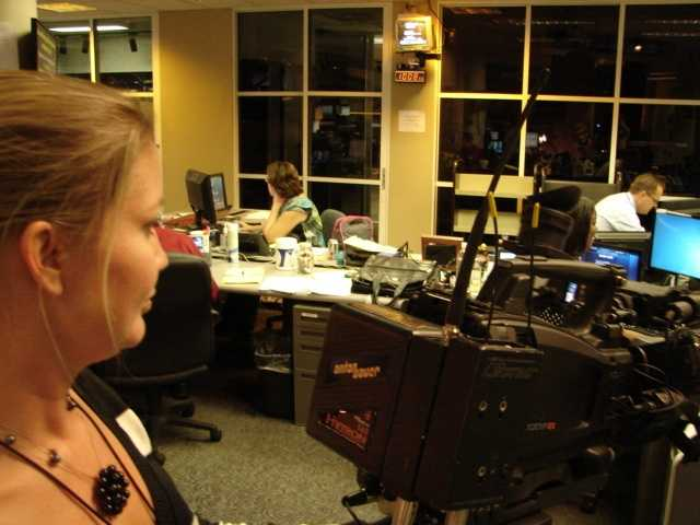 Everyone in the newsroom is hard at work.