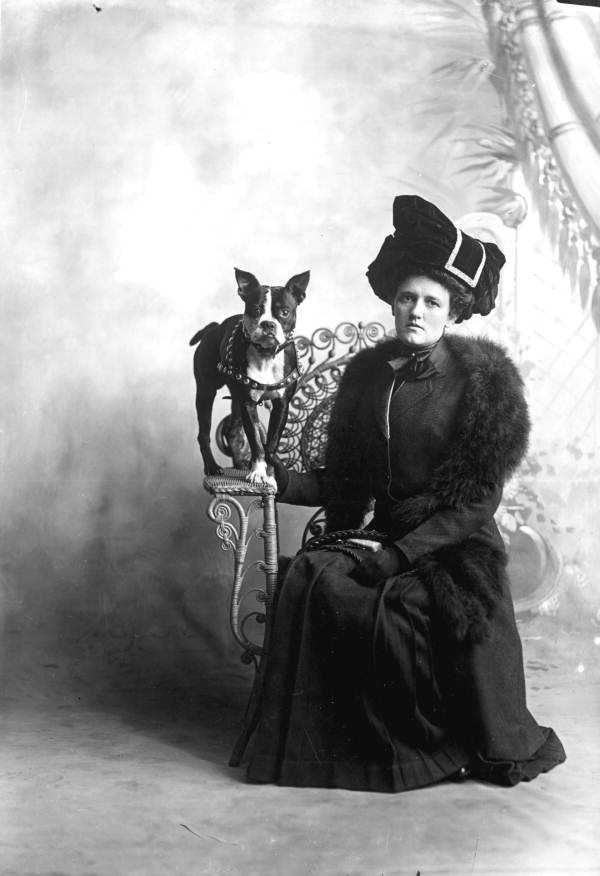 In Pensacola, a woman poses with her dog during the 1800s.
