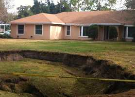 Residents first noticed it Monday and the sinkhole is now about 54 by 52 feet wide and 10 feet deep.