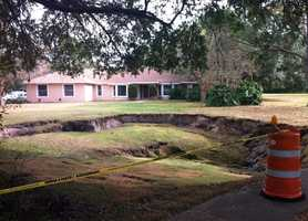 Engineers said the hole is stable for now. Resident Paul Padfield said it grew twice the size since he first saw it.