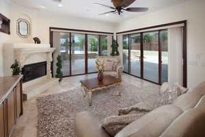 Formal living room overlooking the pool.