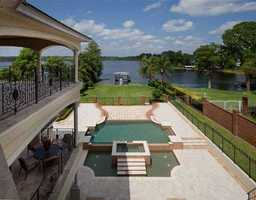 All three balconies wrap around the back of the house and overlook the lake, pool, and jacuzzi. Take your pick.