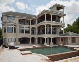 A view of the back of the home allows you to really take in the beauty of the home's architecture.