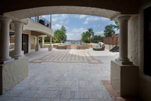 Look out to the pool, from under the arched outdoor areas.