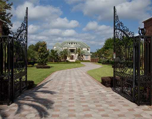 This beautiful extended driveway also offers privacy to residents.