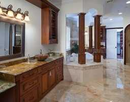 Not your typical bathroom, long counter-tops and spacious tub, which is set aside for privacy and maximum relaxation.
