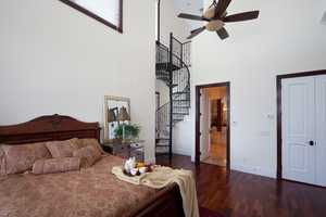 Another bedroom with beautifully, detailed vaulted ceilings.