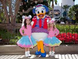 """Sophia Grace and Rosie of """"The Ellen Degeneres Show"""" were at Disney California Adventure park over the weekend to film a segment for the Disney Parks Christmas Day Parade.  The girls took a break to pose with Daisy Duck in front of the Christmas Tree on Buena Vista Street."""