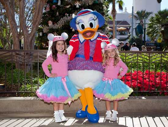 "Sophia Grace and Rosie of ""The Ellen Degeneres Show"" were at Disney California Adventure park over the weekend to film a segment for the Disney Parks Christmas Day Parade.  The girls took a break to pose with Daisy Duck in front of the Christmas Tree on Buena Vista Street."