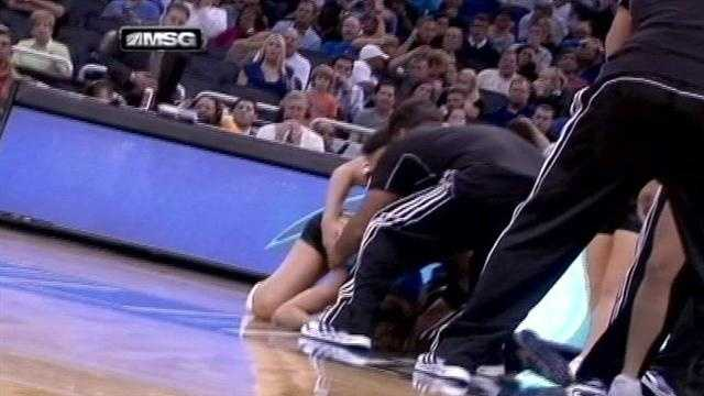 One of the dancers on the Orlando Magic's stunt team was rushed to a hospital Tuesday night after taking a tumble on the court.