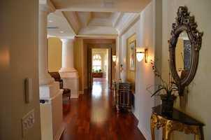 Hardwood floors and custom columns provide a sense of home and glamour.