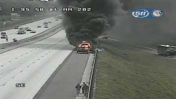 A vehicle caught fire on Interstate 95 southbound in Brevard County and heavy smoke was showing late Wednesday morning.