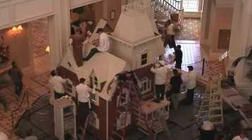The house is made with 1,050 pounds of honey, 700 pounds of chocolate, 600 pounds of powdered sugar and takes about 400 hours to bake the gingerbread and another 160 hours to decorate.