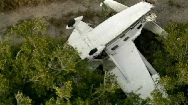 Two people were taken to the hospital after a plane crashed into trees near the Merritt Island Airport on Wednesday afternoon.