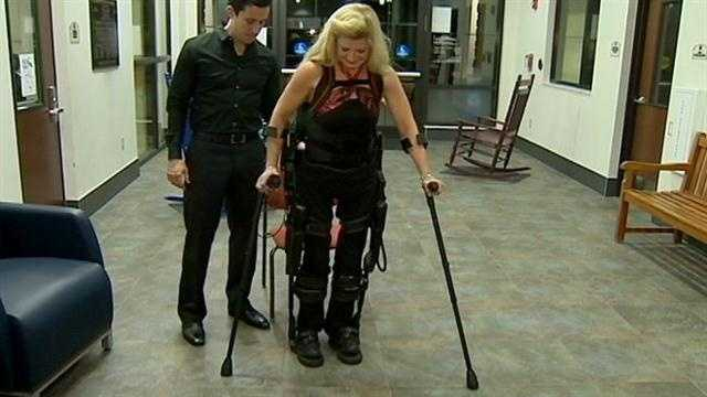 A woman who says she only dreamt of walking again one day after a skiing accident is making strides, thanks to a new bionic suit.