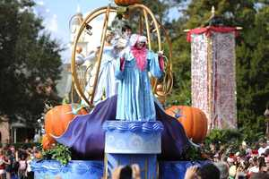 """Characters from Disney's classic animated film """"Cinderella"""" wave to the crowd while taping the """"Disney Parks Christmas Day Parade""""."""
