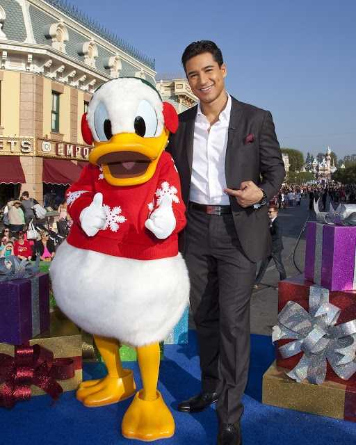 """Mario Lopez poses Nov. 3, 2012, with Donald Duck during the taping of the """"2012 Disney Parks Christmas Day Parade"""" holiday TV special at Disneyland in Anaheim, Calif."""