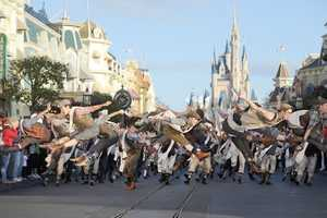 """Cast members from Disney's Tony Award-winning musical """"Newsies"""" dance Dec. 1, 2012 as they tape a segment for the """"Disney Parks Christmas Day Parade""""."""