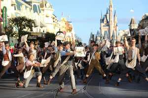 """Corey Cott (front, center), who portrays lead character """"Jack Kelly"""" in """"Newsies: The Musical,"""" joins cast members from Disney's Tony Award-winning musical in a performance Dec. 1, 2012."""