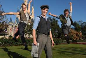 """Cott (center) poses with cast members from Disney's Tony Award-winning musical """"Newsies"""" Dec. 1, 2012 during a break in taping the """"Disney Parks Christmas Day Parade"""" TV special in the Magic Kingdom park."""