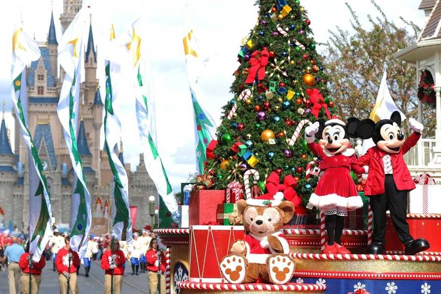 """Mickey and Minnie Mouse wave to the crowd Dec. 1, 2012 while taping the """"Disney Parks Christmas Day Parade."""""""
