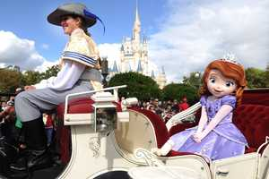 """Disney Junior princess """"Sofia the First"""" takes a royal ride in a horse-drawn carriage."""