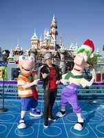 Christian recording artist TobyMac poses with Disney Channel stars Phineas and Ferb during the taping of the 2012 Disney Parks Christmas Day Parade.