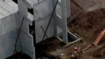 Four construction workers were taken to the hospital after a concrete slab fell on them in Seminole County.