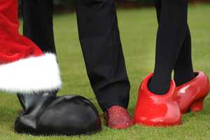 A close-up shows one of actor Cannon's red sparkling holiday shoes Dec. 1, 2012 as he stands with Mickey Mouse and Minnie Mouse.