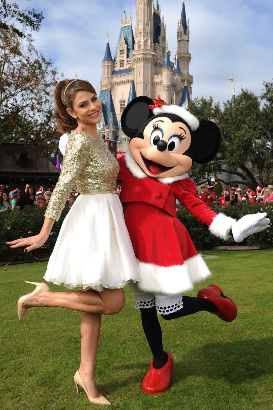 """Actress and entertainment journalist Maria Menounos poses with Minnie Mouse during a break in taping the """"Disney Parks Christmas Day Parade"""" in the Magic Kingdom park at Walt Disney World in Lake Buena Vista, Fla. Menounos is the co-host for the holiday special."""