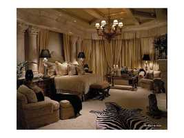 Featuring marble columns and a luxurious sitting area, this is one of six bedrooms.