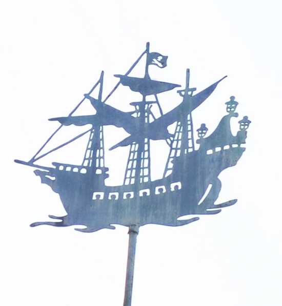 This pirate ship sits high above and is easy to miss.  Where can you find this ship at the Disney parks?