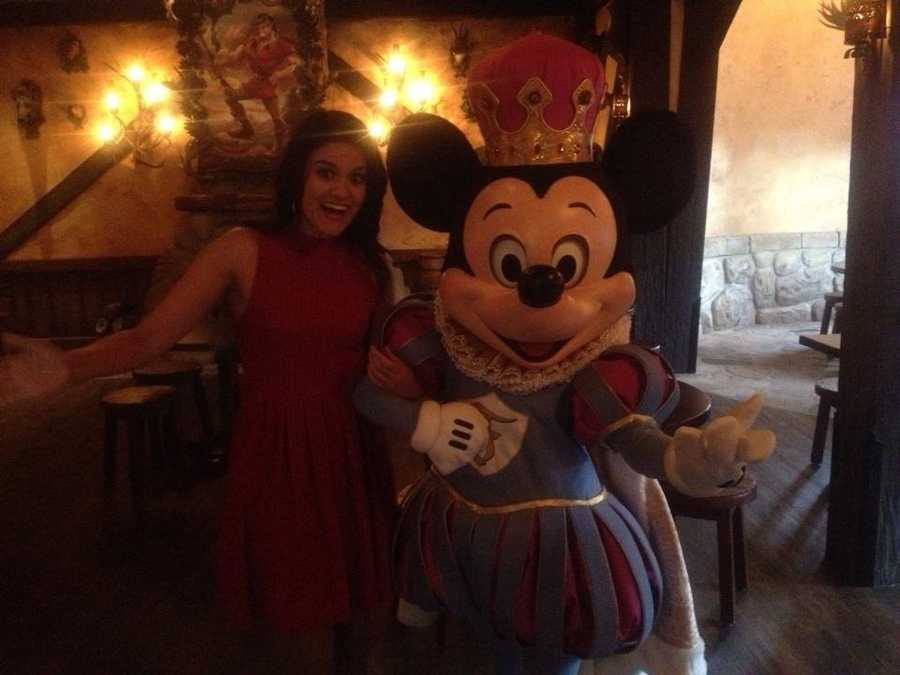 Mickey Mouse grabs some food with Aixa at Gaston's Tavern.