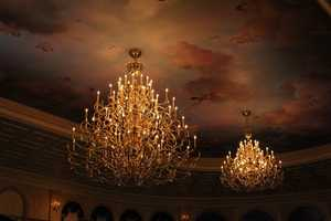 The centerpiece chandelier at the Be Our Guest restaurant measures more than 12 feet tall and 11 feet wide.  It has more than 84 candles and more than 100 jewels that hang down.