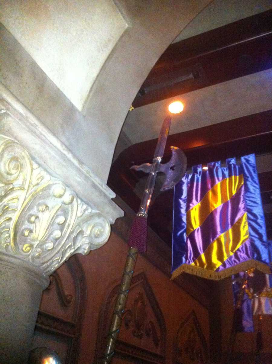 Find the knights, they hold onto this hidden Mickey.  The knights greet guests as they enter the Be Our Guest restaurant.