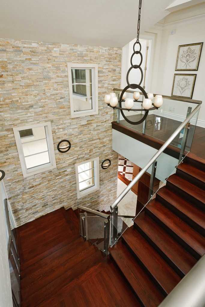 The home features hardwood floors and stone walls.