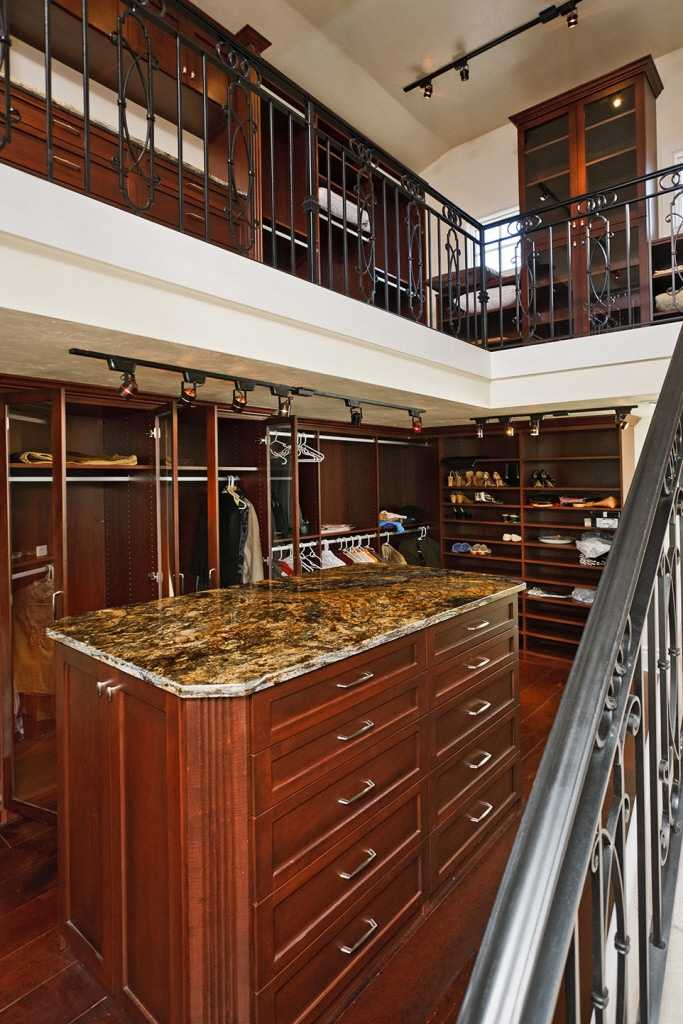 This master closet looks more like a suite itself.