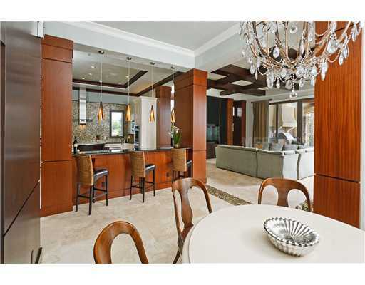 The kitchen overlooks a dining and sitting area.