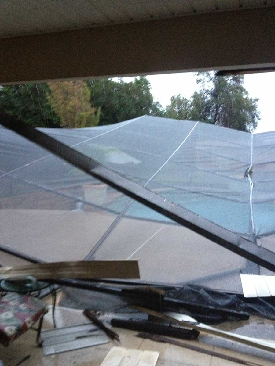 A pool enclosure was destroyed by the storm in Debary.