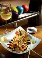 There are two sushi bars -- one on each level where customers can watch chefs roll their hand-made creations and belly-up for a Volcano Roll, Super Tuna or any of the fresh selections.